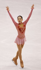 Asada acknowledges fans after performing during the ladies short program competition at the ISU Four Continents Figure Skating Championships in Jeonju