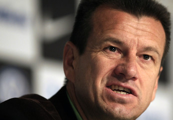 Dunga, head coach of the Brazilian national soccer team, answers a reporter's question during a news conference in Rio de Janeiro
