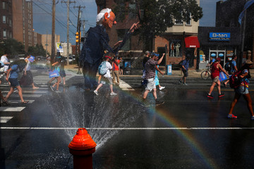 Supporters of U.S. Senator Bernie Sanders carry effigy past hydrant during protest march ahead of 2016 Democratic National Convention in Philadelphia, Pennsylvania