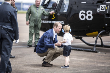 Prince George is told off for running away from him by Prince William during a visit to the Royal international air tattoo at RAF Fairford