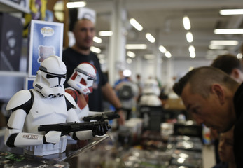 """A visitor looks at some Star Wars characters at the cartoon fair """"Vienna Comix"""" in Vienna"""
