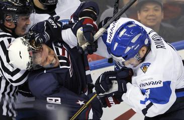 USA's Tynan and Finland's Riikola tangle during their hockey IIHF game in Edmonton