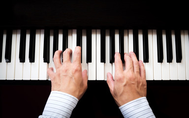 Man hands playing piano. Classical music. Art and abstract background.