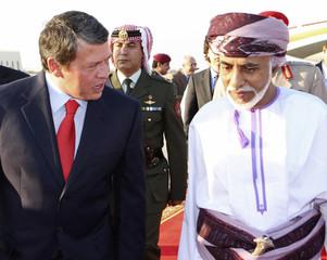 Oman?s Sultan Qaboos welcomes Jordan's King Abdullah upon his arrival at Muscat Airport