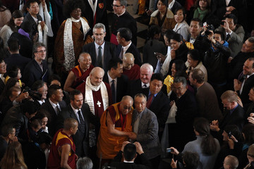 The Dalai Lama  leaves after being awarded the Templeton Prize during his first visit to St Paul's Cathedral in London