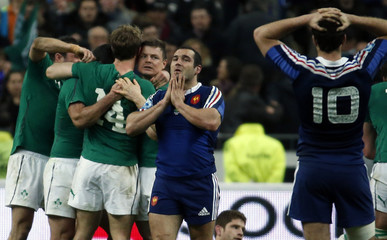 Ireland's Brian O'Driscoll celebrates victory with teammates at the end of their Six Nations rugby union match at the Stade de France in Saint-Denis, near Paris