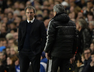 Chelsea's coach Mourinho faces Paris St Germain's coach Blanc during their Champions League quarter-final second leg soccer match at Stamford Bridge in London