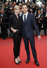Director Xavier Dolan and producer Nancy Grant pose on the red carpet as they arrive at the closing ceremony of the 69th Cannes Film Festival in Cannes