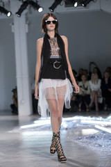A model presents creations from the Spring/Summer 2015 Rodarte collection during New York Fashion Week