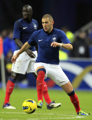 France's Benzema manages the ball during an international friendly soccer match against Belgium at Stade de France's stadium in Saint-Denis