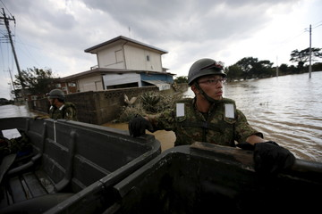 Japanese Self-Defence Force's 1st Infantry Regiment soldiers conduct a search and rescue operation at a residential area flooded by the Kinugawa river, caused by Typhoon Etau at Araigi town in Joso