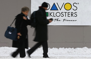 Attendees walk outside the Congress Center during the Annual Meeting 2016 of the WEF in Davos