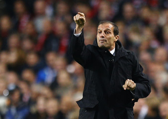 AC Milan's coach Allegri reacts during a Champions League soccer match against Ajax Amsterdam at the Amsterdam Arena stadium