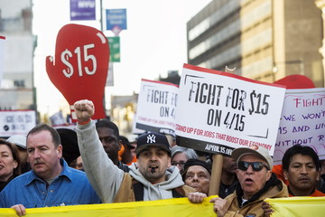 Protesters demonstrate march along Flatbush Avenue for higher wages in the Brooklyn borough of New York City