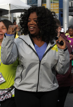 """Winfrey gestures as she starts her charity walk called """"Live Your Best Life Walk"""" in New York"""