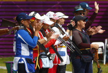 Kimberly Rhode of the U.S. waves at the start of the women's skeet finals at the London 2012 Olympic Games