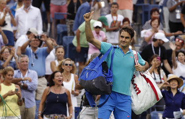 Federer of Switzerland gives a thumbs up gesture as he leaves the court after being defeated by Cilic of Croatia in their semi-final match at the 2014 U.S. Open tennis tournament in New York