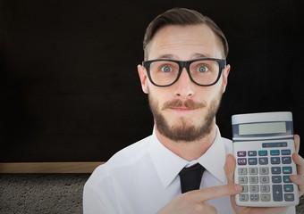 Man with calculator against blackboard