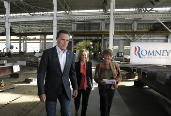 U.S. Republican presidential candidate and former Governor of Massachusetts Romney walks into a campaign event with business owners Grayson and Suppe during a campaign event in Wilmington, Delaware