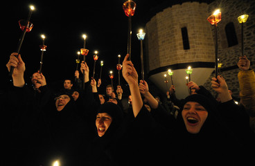 Orthodox Christian nuns sing during a holy Easter service at the St. John the Baptist Monastery near Mavrovo