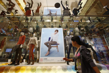 Mannequins wearing cashmere clothes are displayed at Fast Retailing's Uniqlo casual clothing store in Tokyo
