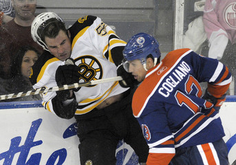 Bruins' Boychuk and Oilers' Cogliano collide during their NHL hockey game in Edmonton