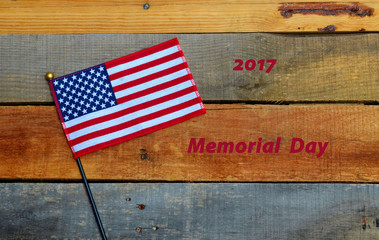 2017 Memorial Day celebration.  USA American flag on pallet wood background.