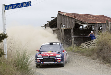 Ogier of France with co-driver Ingrassia drives his Citroen C4 WRC past an old barn on Special Stage 4 on day one of the WRC Rally New Zealand in Northland