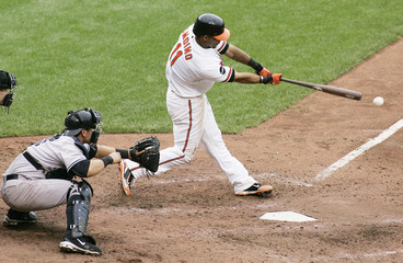Robert Andino of the Orioles gets the game winning hit off Scott Procter of the Yankees in Baltimore