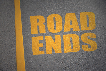 asphalt road with text road ends near yellow line.