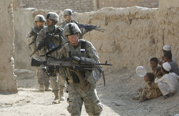 U.S. military policemen from the 504th Military Police Battalion, 170th Company during a patrol in the suburbs of Kandahar city