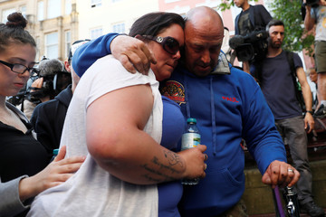 Charlotte Campbell, mother of Manchester Arena attack victim Olivia Campbell and stepfather Paul Hodgson pay their respect in St Ann's Square for the victims in central Manchester