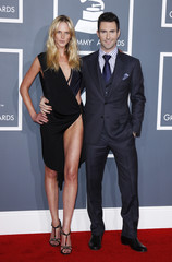 Adam Levine of Maroon 5 and Anne Vyalitsyna arrive at the 54th annual Grammy Awards in Los Angeles, California