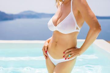 Sexy curvy woman in white bikini