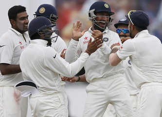 India's Pujara celebrates with captain Kohli, Mishra, Sharma and Ashwin after taking the catch to dismiss Sri Lanka's Thirimanne during the fifth day of their second test cricket match in Colombo