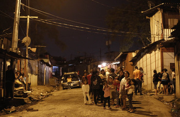 People wait to receive food in Triangulo de la Solidaridad, a low-income neighbourhood, north of San Jose