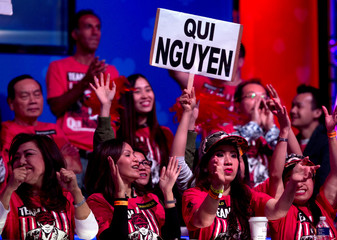 Supporters of Qui Nguyen celebrate as Nguyen wins a hand during the World Series of Poker Main Event in Las Vegas