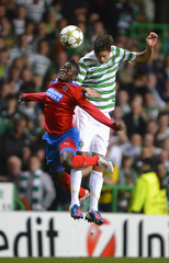 Celtic's Mikael Lustig challenges Helsingborgs IF's David Accam during their Champions League play-off round second leg soccer match at Parkhead stadium in Glasgow, Scotland