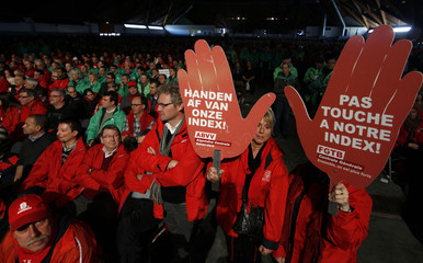 Members of Belgian trade unions gather for a meeting in Brussels