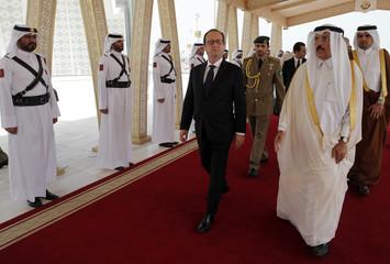 French President Hollande is greeted by Culture minister of Qatar Dr. Hamad Bin Abdulaziz Al-Kuwari at the Doha airport, Qatar