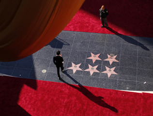 Security guard patrols red carpet arrivals area along Hollywood Boulevard, in preparation for the 85th Academy Awards in Hollywood