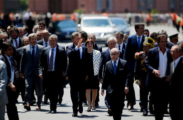 Argentina's President Macri waves as he walks towards Buenos Aires' Cathedral for a traditional Te Deum mass in Buenos Aires
