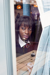 killing look of Woman looking through a glass window