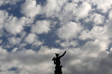 A statue of Roman god Mercury is seen on top of a building, in the old part of Ljubljana