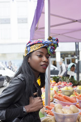 Woman wearing a headscarf at a fruit market