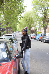 Young woman getting in a car