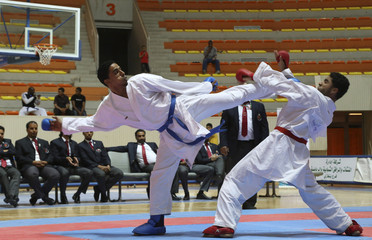Omar kicks Omar during their under 84kg category gold medal match at the 22nd Karate Championship in Benghazi