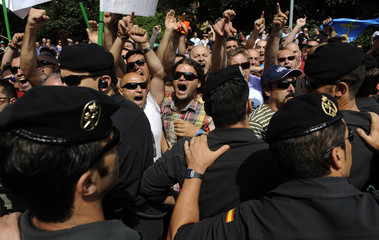 A group of coal miners protests during inauguration ceremony of Parador de Corias hotel in Cangas del Narcea