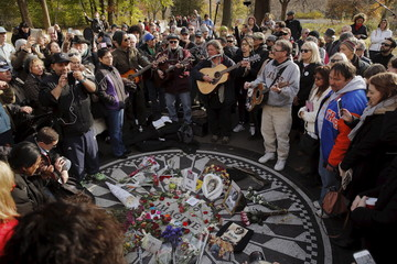 Fans of former Beatle Lennon gather at the Imagine mosaic in the Strawberry Fields section of New York's Central Park to mark the 35th anniversary of his death, in New York