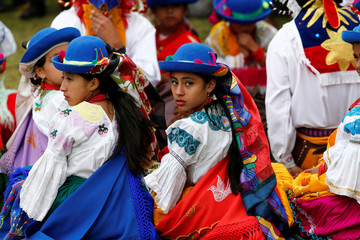 Dancers wait to perform at a indigenous tradicional ceremony for Ecuador's President Lenin Moreno in Cochasqui